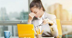 Stressed Businesswoman Needing Help of TaxBandits