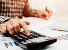 Owner calculating small business payroll