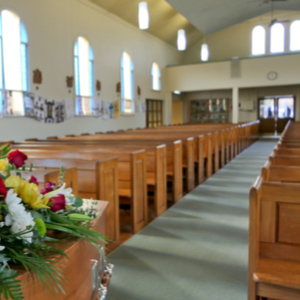 Large funeral parlor prepared for a service by funeral directors