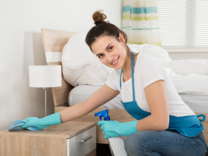 Owner of Home Cleaning Services business completing housekeeping job