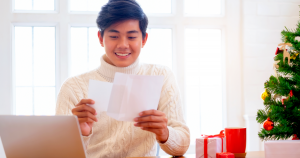 Small business manager organizing records from sales during the holiday season